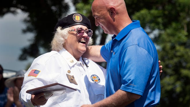 Donna Keefer, of Vietnam Veterans Chapter 1032, left, presents Philip Palandro, York County Veteran Affairs, an award for his service.