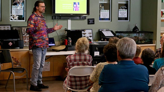 Dr. Sean Bush, professor of emergency medicine at East Carolina University, delivers a lecture on treating snakebites for a crowd of over 50 Wednesday evening at River Bend Nature's Center.