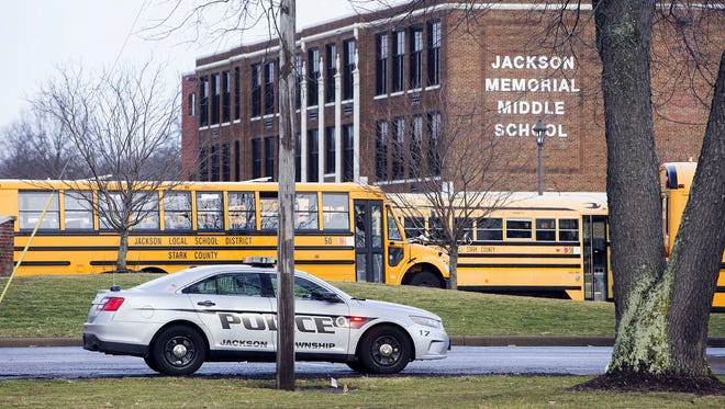 A police car is parked outside Jackson Memorial Middle School in Massillon, Ohio, on Tuesday, Feb. 20, 2018. A school official said a middle school student apparently shot himself after bringing a gun to school.