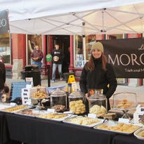 Jenna Irving works at her Little Morocco stand at the Winter Downtown Farmers Market.