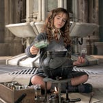 "Emma Watson in a scene from ""Harry Potter and the Chamber of Secrets."""