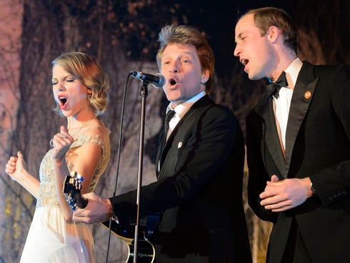 Britain's Prince William, Duke of Cambridge, right, sings with Taylor Swift and Jon Bon Jovi at the Centrepoint Gala Dinner at Kensington Palace in London on Tuesday, Nov. 26, 2013.