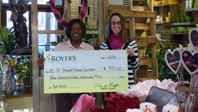 From left: Candace Oliver, manager trainee at Royer's Flowers in Lebanon, and Kristen Snoke, community outreach director, Pennsylvania Breast Cancer Coalition. Oliver is wearing one of the pink polo shirts Royer's employees purchased to raise money for the coalition.