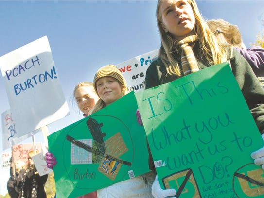 People protest outside Burton's headquarters in Burlington