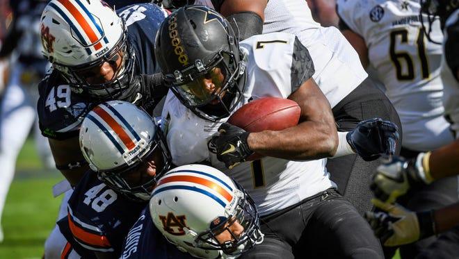 Vanderbilt's Ralph Webb (7) is brought down by Auburn's Darrell Williams (49), Montavious Atkinson (48) and  Carlton Davis (6) on Nov. 5, 2016.