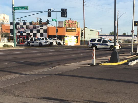 A man stabbed a Phoenix police officer before the officer shot the suspect near 16th and Van Buren streets on March 11, 2015.