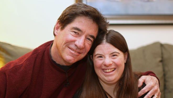 "Paul Daugherty with his daughter, Jillian Daugherty, 25. Daugherty has written a memoir, ""An Uncomplicated Life,"" about daughter Jillian, who has Down syndrome."
