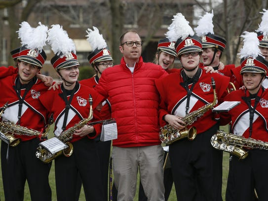 Band director Micah Hoffman, center, and the Lincoln
