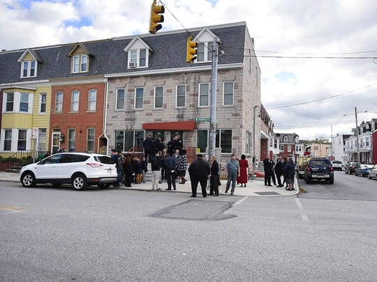 A satellite location for the York City Police Department is returning to the city's Salem Square neighborhood after a one-year absence. City officials shared the news Tuesday afternoon on the steps of Gus' Place, a former bar at 596 W. Princess St.