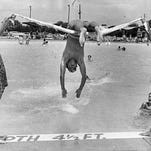 Westlake Beach Club turned into a miniature Coney Island as bathers dotted the beach in 1951.
