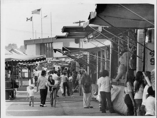What would a fair be like without a midway?  That was the caption on this archive photo from August 1975.