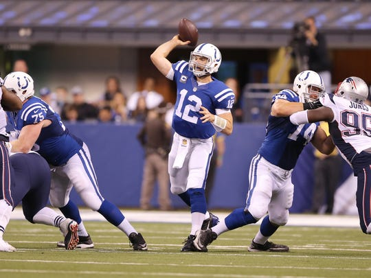 Indianapolis Colts quarterback Andrew Luck (12) is protected by his offensive line as he throws, New England Patriots at Indianapolis Colts, Sunday, Oct. 18, 2015.
