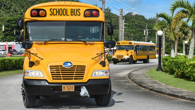 Department of Public Works school buses arrive at Adelup on Wednesday, Aug. 16, 2017.