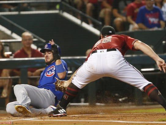 Cubs baserunner Kris Bryant (17) slides in safe at