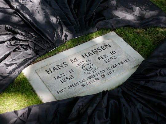 The grave marker honoring Hans M. Hansen, the first