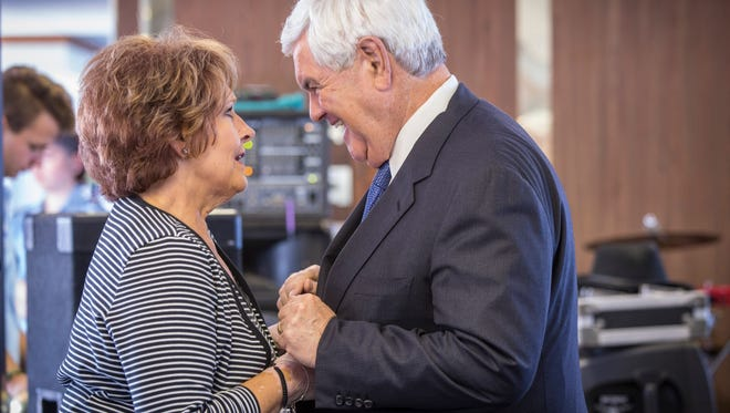 Former Speaker of the House Newt Gingrich embraces state Rep.Linda Upmeyer Speaker of the Iowa House of Representatives on a First in the Nation Boat Cruise during the 2016 Republican National Convention in Cleveland.