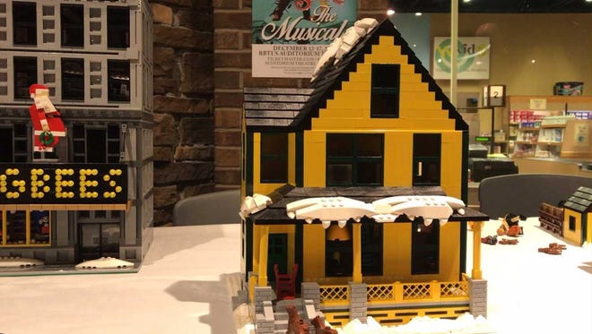 The Middaugh family made Ralphie's house from A Christmas Story out of Legos.