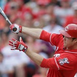 Cincinnati Reds' Brennan Boesch hits a single to drive home Jay Bruce during the seventh inning of a baseball game against the Washington Nationals, Sunday, May 31, 2015, in Cincinnati. The Reds won 8-2. (AP Photo/John Minchillo)