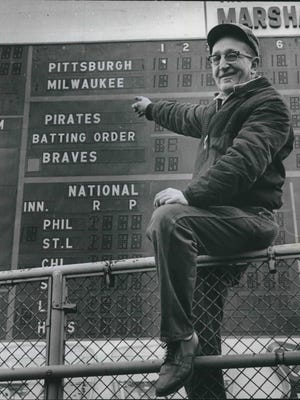 Everything is in readiness at County Stadium for opening day of the 1966 baseball season - provided, that is, a court can force the Braves to return to Milwaukee. Pointing to the scoreboard, which shows Pittsburgh at Milwaukee, is Edward Tuchalaski, a County Park Commission employee. This photo was published in the April 3, 1966, Milwaukee Sentinel.
