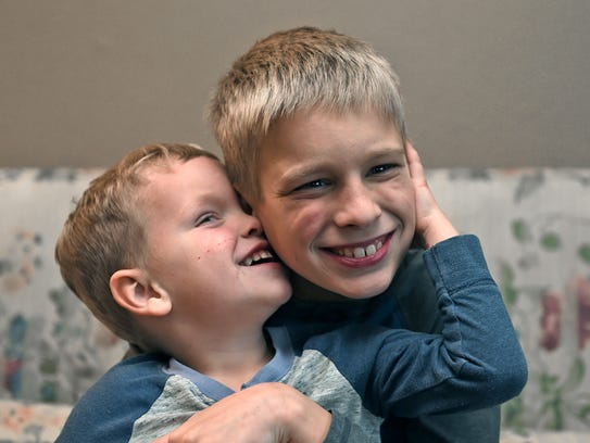 Dixie Rose Callan's two sons Jayse, 3, and Joseph, 9, pose for a photo in their Reno apartment. Callan overcame drug addiction.