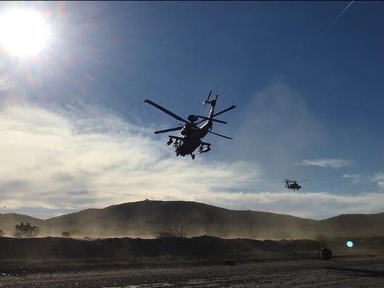 An Apache helicopter with Charlie Troop, 3-6 Cav flies