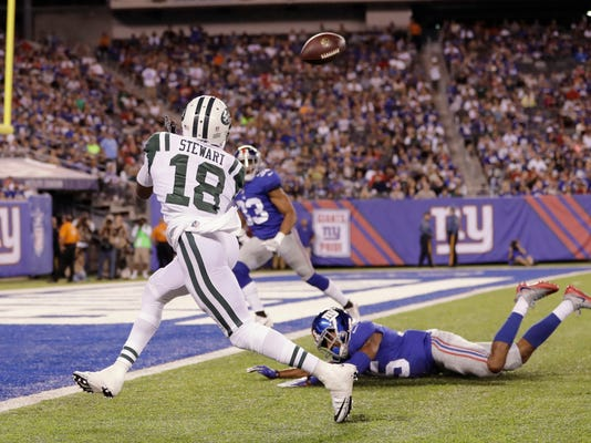 New York Jets' ArDarius Stewart (18) catches a pass for a touchdown in front of New York Giants' Nigel Tribune (35) during the second half of a preseason NFL football game Saturday, Aug. 26, 2017, in East Rutherford, N.J. (AP Photo/Julio Cortez)