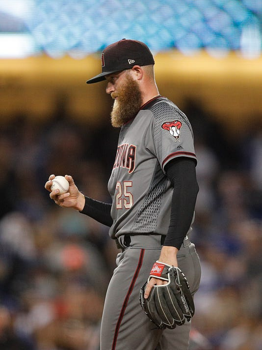 Arizona Diamondbacks relief pitcher Archie Bradley stands on the mound after giving up a two-run single to Los Angeles Dodgers' Chase Utley during the eighth inning of a baseball game, Friday, April 13, 2018, in Los Angeles. (AP Photo/Jae C. Hong)