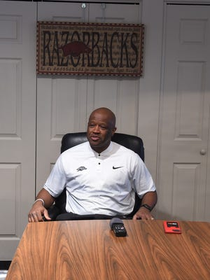 Arkansas men's basketball Coach Mike Anderson speaks with members of the media before attending the Baxter County Razorback Club's annual banquet Thursday evening. Razorback fans should give next year's team a chance to grow into themselves, Anderson said.