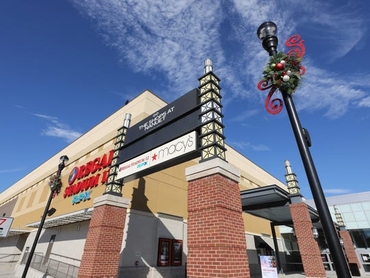 Light posts are decorated at The Shops at Nanuet in