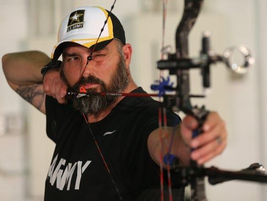 "Shawn ""Bubba"" Vosburg practices his archery skills"