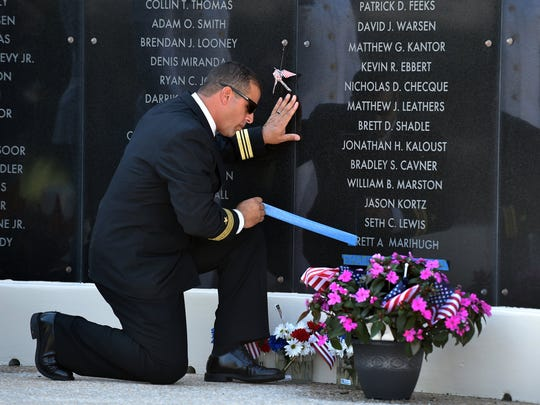 U.S Navy SEAL Lt. Commander (Ret.) Hector Delgato, of Jupiter, uncovered the name of Brett Marihugh as three new names were unveiled on the memorial wall at the National Navy UDT-SEAL Museum during their annual Memorial Day service May 30, 2016 in Fort Pierce.