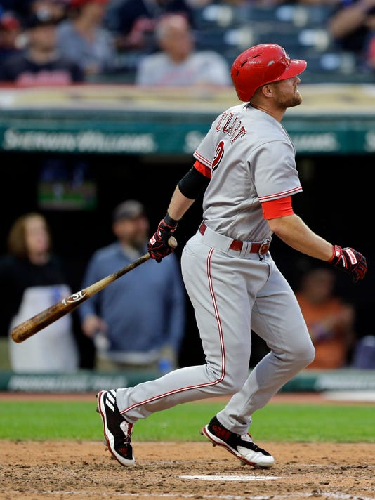 Cincinnati Reds shortstop Zack Cozart watches his solo home run off Cleveland Indians starting pitcher Josh Tomlin in the sixth inning of a baseball game, Monday, July 24, 2017, in Cleveland. (AP Photo/Tony Dejak)