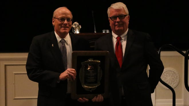 Kenny Bounds (left), a retired executive with MidAtlantic Farm Credit, was honored Jan. 21 by Delaware ag secretary Ed Kee.