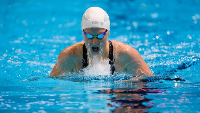 Fossil Ridge's Zoe Bartel swims during the women's 200-meter individual medley preliminary heats in the U.S. Olympic swimming team trials at CenturyLink Center on Tuesday.
