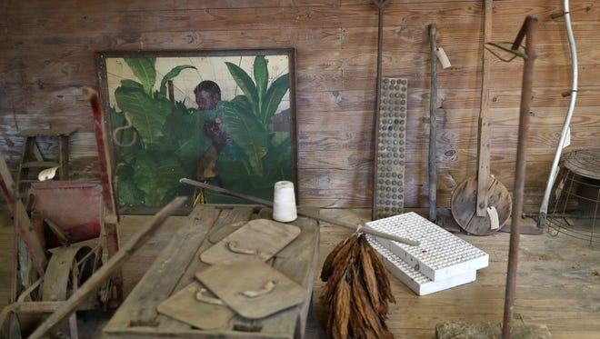 Tools and artwork are set for display for the Shade Tobacco Museum.