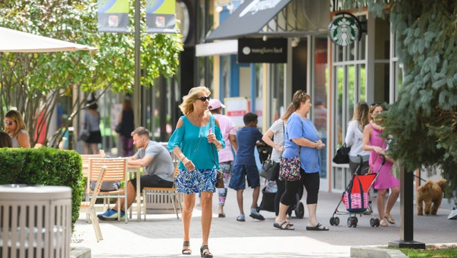 Shoppers enjoy a warm summer afternoon at the outdoor Patridge Creek, in Clinton Two., July 18, 2018.