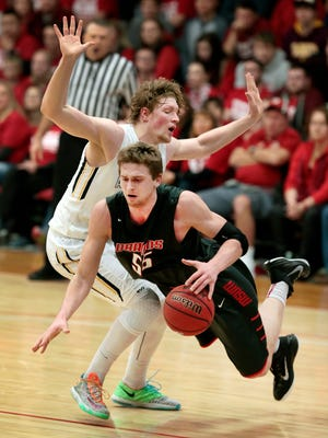Isaac Sevlie of Minnesota State University Moorhead collides under the basket with Daniel Jansen of Augustana during the Saturday, Feb. 6, 2016, game at MSUM. Dave Wallis / The Forum