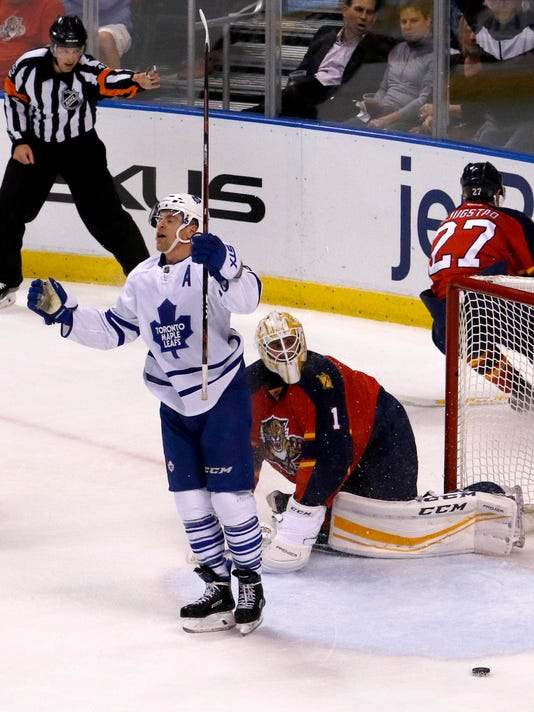 Toronto Maple Leafs right wing Michael Grabner (40) celebrates his score against Florida Panthers goalie Roberto Luongo (1) in the first period of an NHL hockey game Tuesday, March 29, 2016, in Sunrise, Fla. (AP Photo/Joe Skipper)