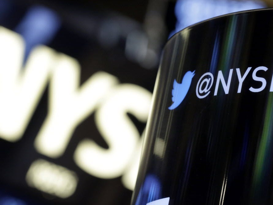 n this Monday, Nov. 4, 2013, file photo, a phone post on the floor of the New York Stock Exchange features a Twitter logo, in New York.
