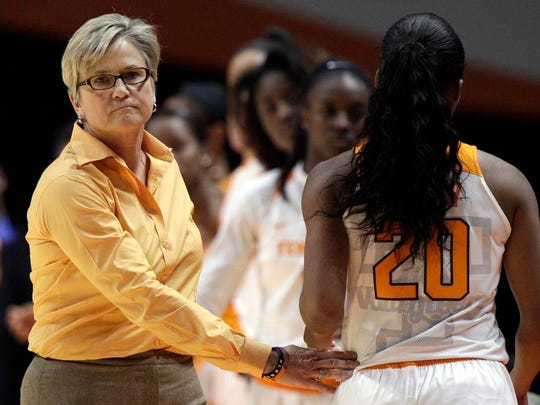 Tennessee coach Holly Warlick pats guard Te'a Cooper (20) as she leaves the game against Virginia Tech in the second half on Dec. 6, 2015. UT lost 57-43.