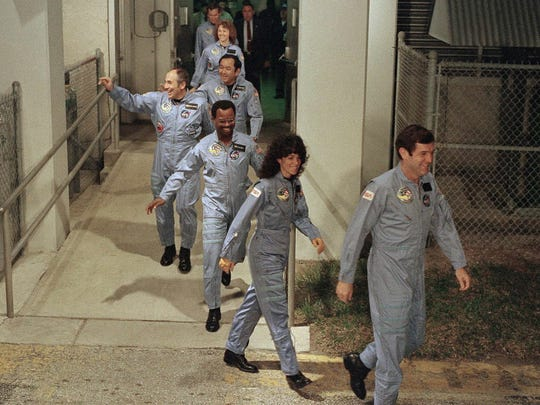 The crew for the space shuttle Challenger leaves their quarters for the launch pad at Kennedy Space Center in Cape Canaveral in January 1986. From foreground are Commander Francis Scobee, Mission Specialist Judith Resnik, Mission Specialist  Ronald McNair, Payload Specialist Gregory Jarvis, Mission Specialist Ellison Onizuka, teacher Christa McAuliffe and Pilot Michael Smith.