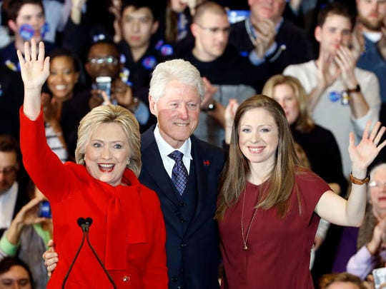 The Clintons greet supporters in Des Moines on Feb.