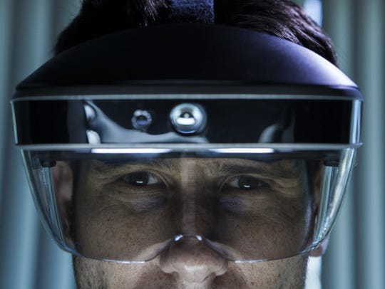 The Meta 2 headset projects holograms into the wearer's