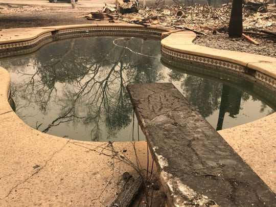 The Carr Fire burned a diving board next to a pool filled with ashes off Swasey Drive.
