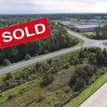 A wooded tract at the Route 50 Bypass and Naylor Mill Road has been sold to a developer.