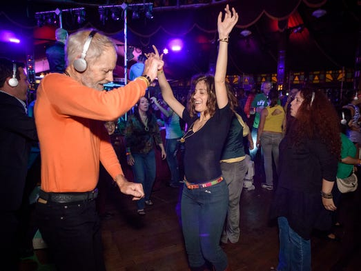 Partygoers danced to their own beat at Silent Disco during the Fringe Festival.