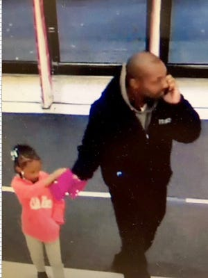 Police are trying to find this man and the girl after he allegedly pulled her out of a Burlington Coat Factory store in Southfield on Tuesday, Oct. 31, 2017.