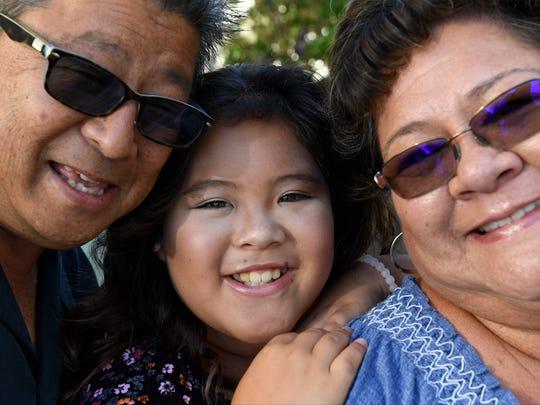Kylee Uradomo with her parents David and Janet