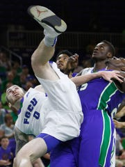FGCU's Brett Comer is fouled by Corpus Christi, flipping upside-down and injuring his right wrist Wednesday at the2015CTI.com tournament.