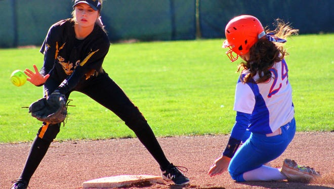 Alamogordo freshman shortstop Taylor Murphy, left, receives a throw from the catcher Thursday morning at Cleveland High School.